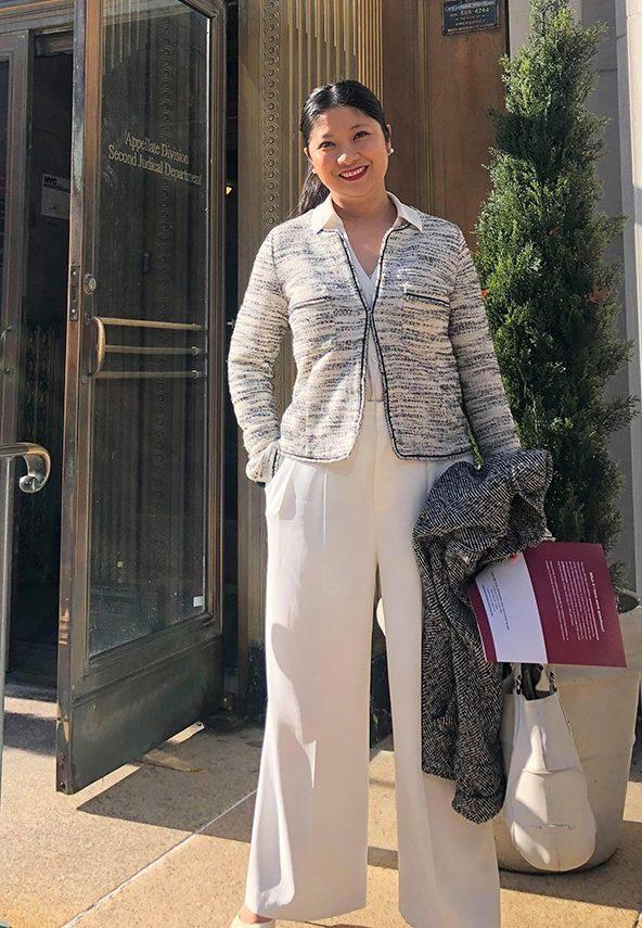 Diane Morota Mantaring standing in front of building.